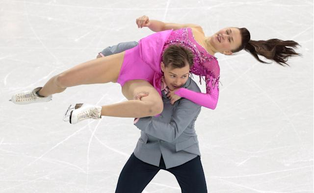 Julia Zlobina and Alexei Sitnikov of Azerbaijan compete in the ice dance short dance figure skating competition at the Iceberg Skating Palace during the 2014 Winter Olympics, Sunday, Feb. 16, 2014, in Sochi, Russia. (AP Photo/Ivan Sekretarev)