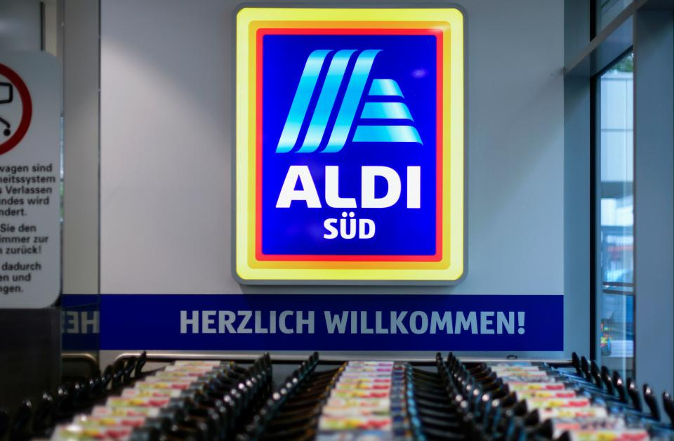 Shopping carts stand under a logo of food discounter ALDI-Sued at the entrance of a shop in Duesseldorf, western Germany, on April 29, 2020 amid the novel coronavirus COVID-19 pandemic. - From April 29, 2020 in Germany, masks are needed to enter shops, which began to open last week after the government declared its outbreak under control. Nose and mouth coverings are already compulsory on buses, trains and trams. (Photo by Ina FASSBENDER / AFP) (Photo by INA FASSBENDER/AFP via Getty Images)