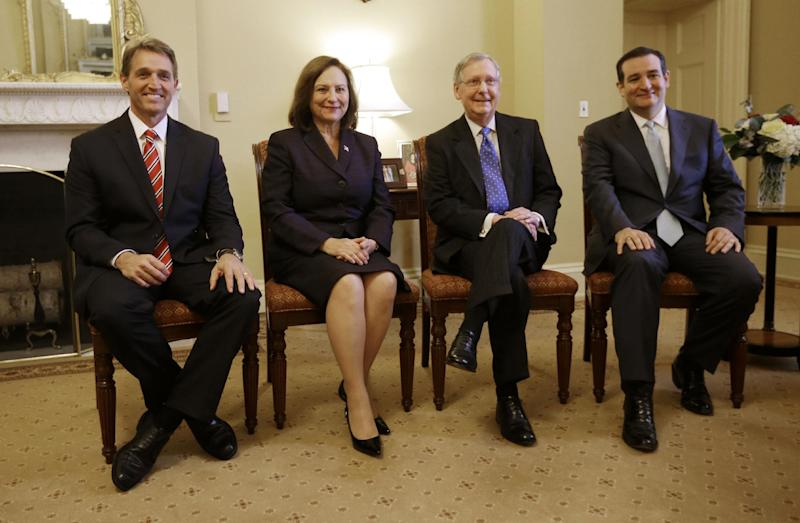 Senate Minority Leader Mitch McConnell of Ky., second from right, meets with newly elected GOP Senators, Tuesday, Nov. 13, 2012, on Capitol Hill in Washington. From left are, Sen-elect Jeff Flake, R-Ariz., Sen-elect Deb Fischer, R-Neb, McConnell, and Sen-elect Ted Cruz, R-Texas. (AP Photo/Pablo Martinez Monsivais)