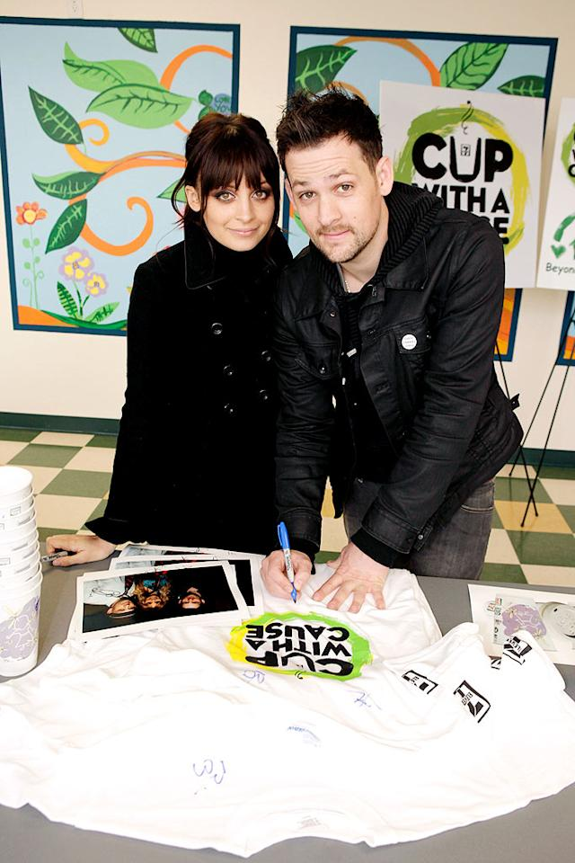 """Nicole Richie and Joel Madden launched the """"7-Eleven's Coffee Cup with a Cause"""" at Beyond Shelter Neighborhood Resource Center in LA on Tuesday. 7-Eleven will donate proceeds from coffee cups designed by Richie to the Richie-Madden Children's Foundation between now and March 15, with a guaranteed minimum donation of $250,000. Jeff Vespa/<a href=""""http://www.wireimage.com"""" target=""""new"""">WireImage.com</a> - February 9, 2010"""