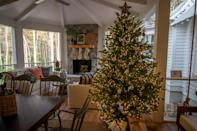 <p>Bring the cheer out to the screened porch with a sparkling tree from The Home Depot to admire while curled up by the fire. </p>