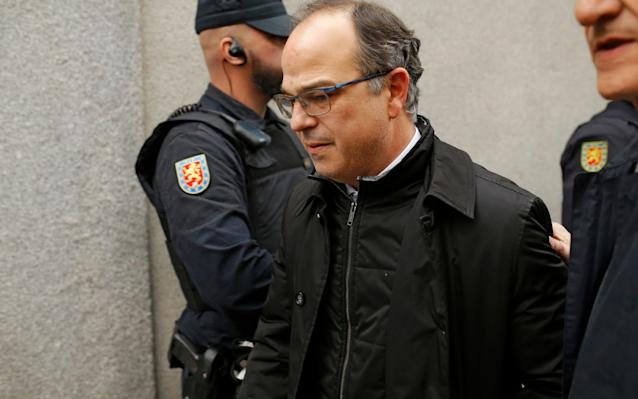 "Spain's Supreme Court on Friday opened rebellion prosecutions against 13 Catalan independence leaders, jailing the proposed successor to deposed president Carles Puigdemont hours ahead of his planned inauguration. Judge Pablo Llarena charged Mr Puigdemont and other separatist politicians with crimes that could see them sent to prison for up to 30 years over their role in October's banned referendum and declaration of independence. Jordi Turull, the latest presidential candidate, was last night ordered into preventative prison along with four others, a move that will frustrate secessionists' efforts to have him inaugurated in a session scheduled for Saturday morning. Supreme Court judge Pablo Llarena also issued international arrest warrants against Catalonia's former president Carles Puigdemont and four others involved in the region's independence movement who are now in self-imposed exile in Belgium. An international warrant was also issued for a sixth Catalan separatist Marta Rovira who failed to appear in court on Friday and is now in non-EU Switzerland, according to Spanish media. Pro-independence demonstrators hold signs reading ""United against repression"" during a protest Credit: LUIS GENE/AFP/Getty Images Mr Turull is pro-independence parties' ""Plan C"" to form an autonomous government and lift direct rule, after previous presidential candidates including Mr Puigdemont were blocked by the courts. On Thursday, Mr Turull lost a first round of voting after the abstention of hard line secessionist party the CUP, forcing today's second round at which he must be present. In response, thousands of pro-independence supporters took to the streets across Catalonia. Twenty-four protesters were lightly injured in clashes with police, emergency services said. Riot police used batons to keep the demonstrators away from the federal government offices in Barcelona. Demonstrators light flares during a protest called by pro-independence movements in Barcelona Credit: PAU BARRENA/AFP The judge ruled that the five - who had previously been bailed while under investigation - posed a high risk of reoffending or fleeing the country. Opening the prosecutions, Mr Llarena accused the politicians of adopting a ""criminal design"" to procure an independent Catalan Republic, a drive which he judged they had not relinquished. As well as former government members, rebellion charges were also brought against the two jailed protest leaders, Jordi Sanchez and Jordi Cuixart, the former parliamentary speaker Carmen Forcadell, and the secretary-general of the pro-independence party ERC, Marta Rovira. Twelve other secessionist politicians will be tried for lesser crimes of disobedience and misappropriation of public funds. How Pep Guardiola became Catalonia's political totem Ms Rovira refused to appear at Friday's hearing, instead becoming the seventh Catalan separatist to flee the country. In a letter to Catalan media, she said she had chosen ""the path of exile"" as the only way to ""recover (her) political voice"" in the face of a government that ""is willing to violate the rule of law and civil liberties to achieve its political ends"". Ms Rovira, who made no mention of her whereabouts, said fleeing was also the only way to continue being a mother to her daughter, Inés. Mr Puigdemont, who left for Belgium along with four cabinet members in late October, said on a visit to Helsinki that he gave his ""total support"" to Ms Rovira, of whose plans he insisted he had had no knowledge. She ""has a right to defend herself in a setting where rights are respected,"" he added. Carlos Carrizosa, the Catalan parliamentary spokesman for the unionist party Ciudadanos, said that with the failure to approve Mr Turull as president on Thursday, it was clear the independence process was ""finished"". Ms Rovira's flight, he added, showed it was now ""every man for himself""."