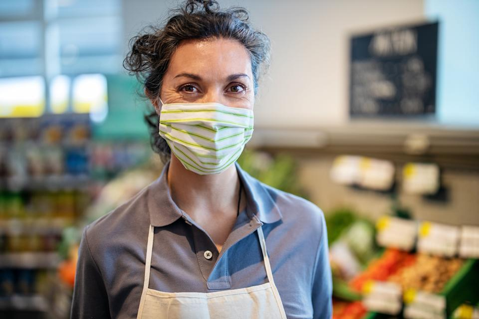 The CDC's new mask guidelines have workers wondering about the implications for their own jobs. (Photo: Luis Alvarez via Getty Images)