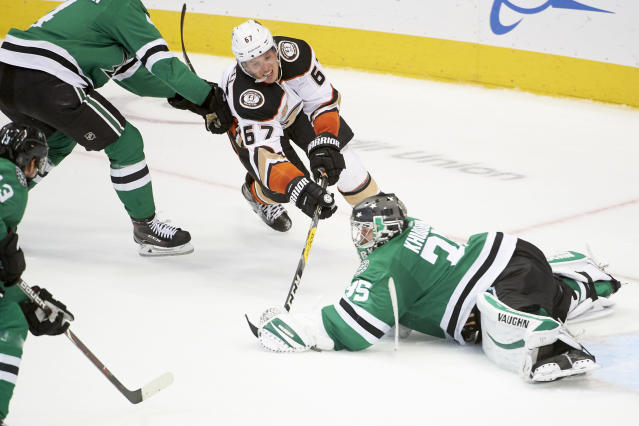 Dallas Stars goaltender Anton Khudobin (35), of Kazakhstan, stops a shot by Anaheim Ducks center Rickard Rakell (67), of Sweden, during the third period of an NHL hockey game Saturday, Oct. 13, 2018, in Dallas. (AP Photo/Cooper Neill)