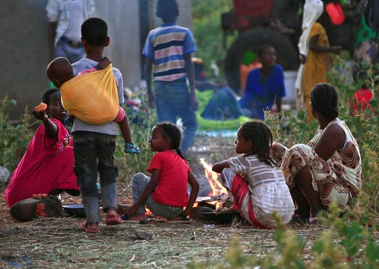 Ethiopian refugees who fled fighting in Tigray province at a reception centre in eastern Sudan's Gedaref province