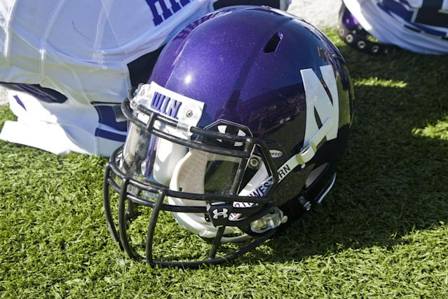 Northwestern's helmet seen on the field before an NCAA college football game. (AP)