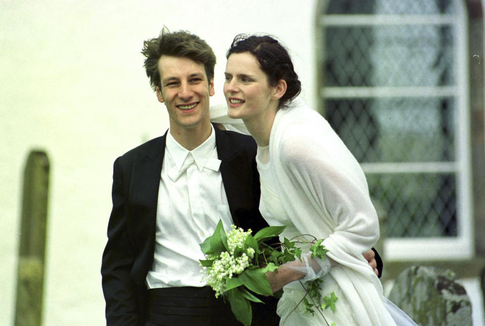 """FILE In this May 22, 1999 file photo, Stella Tennant with French born David Lasnet on their wedding day in Oxnam, on the Scottish Borders. Tennant, the aristocratic British model who was a muse to designers including Karl Lagerfeld and Gianni Versace, has died suddenly at the age of 50, her family said Wednesday, Dec. 23, 2020. The family asked for their privacy to be respected and said Tennant was """"a wonderful woman and an inspiration to us all."""" Police Scotland said there were no suspicious circumstances. (David Cheskin/PA via AP, FIle)"""