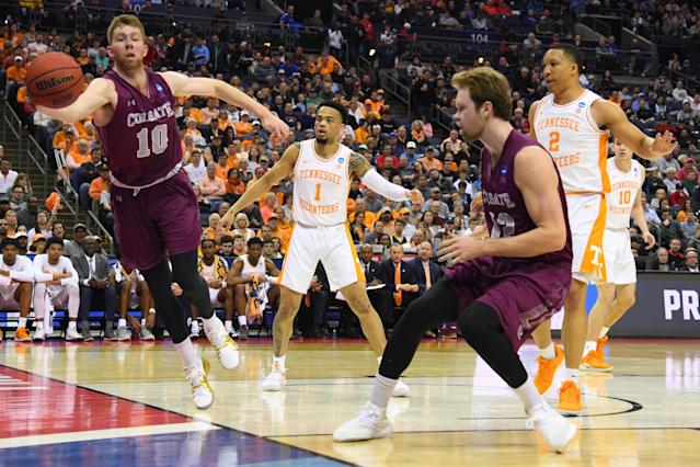 <p>Will Rayman #10 of the Colgate Raiders save the ball from going out of bnounds against Tennessee Volunteers in the first round of the 2019 NCAA Men's Basketball Tournament held at Nationwide Arena on March 22, 2019 in Columbus, Ohio. (Photo by Jamie Schwaberow/NCAA Photos via Getty Images) </p>