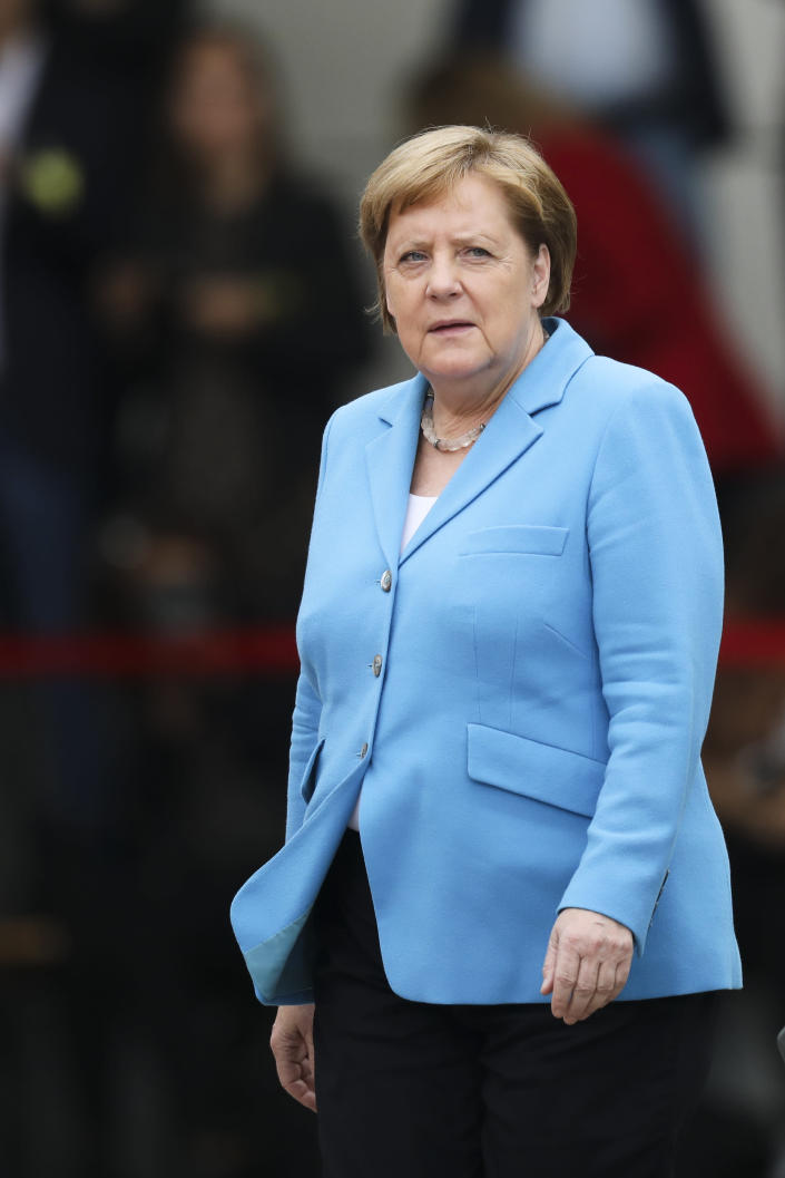 German Chancellor Angela Merkel waits for the arrival of the Prime Minister of Finland Antti Rinne for talks at the chancellery in Berlin, Wednesday, July 10, 2019. (AP Photo/Markus Schreiber)