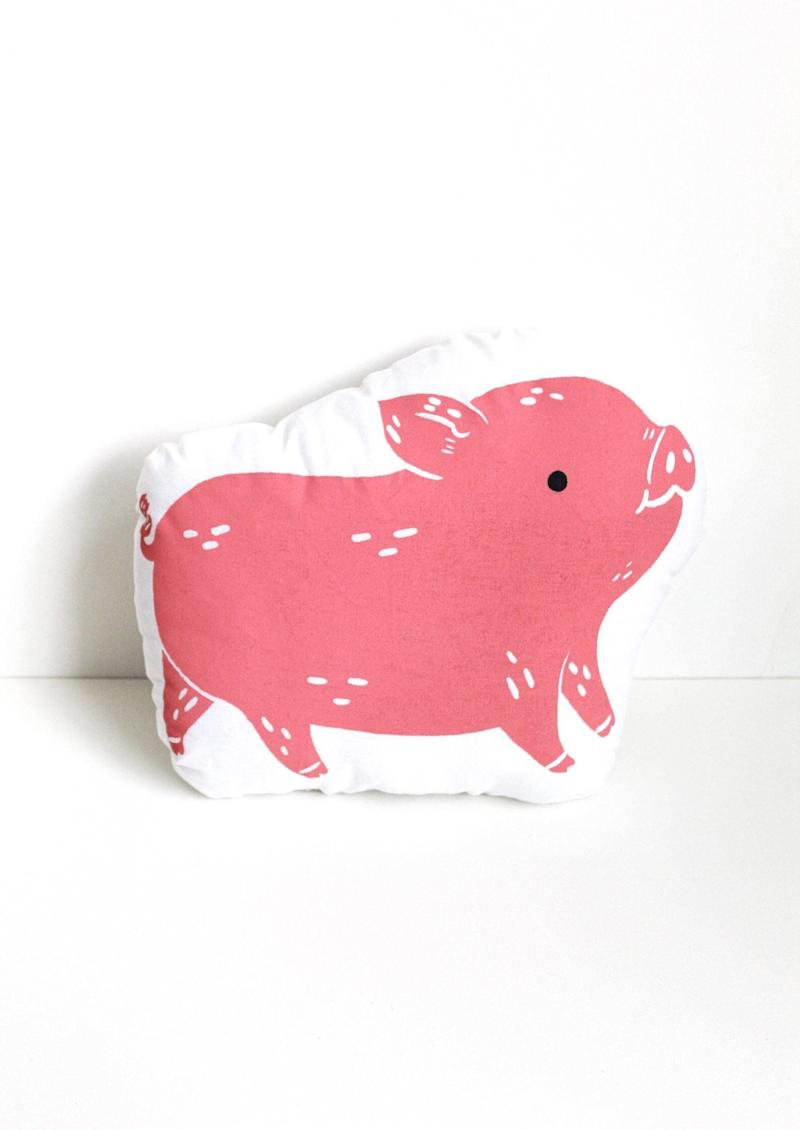 """The cutest pillow we ever did see! <a href=""""https://www.etsy.com/ca/listing/168885672/pig-shaped-farm-animal-pillow-hand?ref=user_profile&amp;pro=1"""" target=""""_blank"""" rel=""""noopener noreferrer"""">Get it for $24 on Etsy.</a>"""