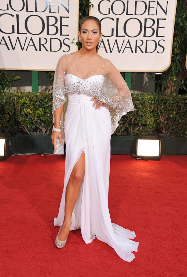 How did Jennifer Lopez manage to hit $5 million with her look at last year's Golden Globes? She combined a Zuhair Murad designer gown, Christian Louboutin heels and a Harry Winston cuff loaded with over 600 diamonds. Factor in $3 million Harry Winston cluster earrings, a diamond ring with an impressive 7 carat diamond, along with a diamond cluster hair brooch, and it starts to add up.