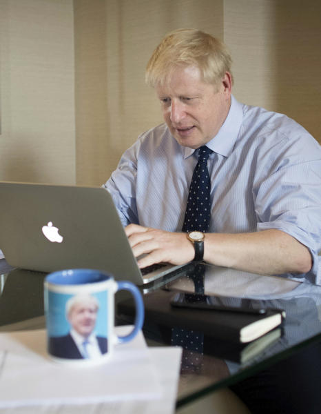 Britain's Prime Minister Boris Johnson prepares his keynote speech, that he is due to deliver to delegates at the Conservative Party conference in Manchester, England, Tuesday Oct. 1, 2019.  Johnson is scheduled to deliver his keynote speech to the party's annual conference on Wednesday. (Stefan Rousseau/Pool via AP)