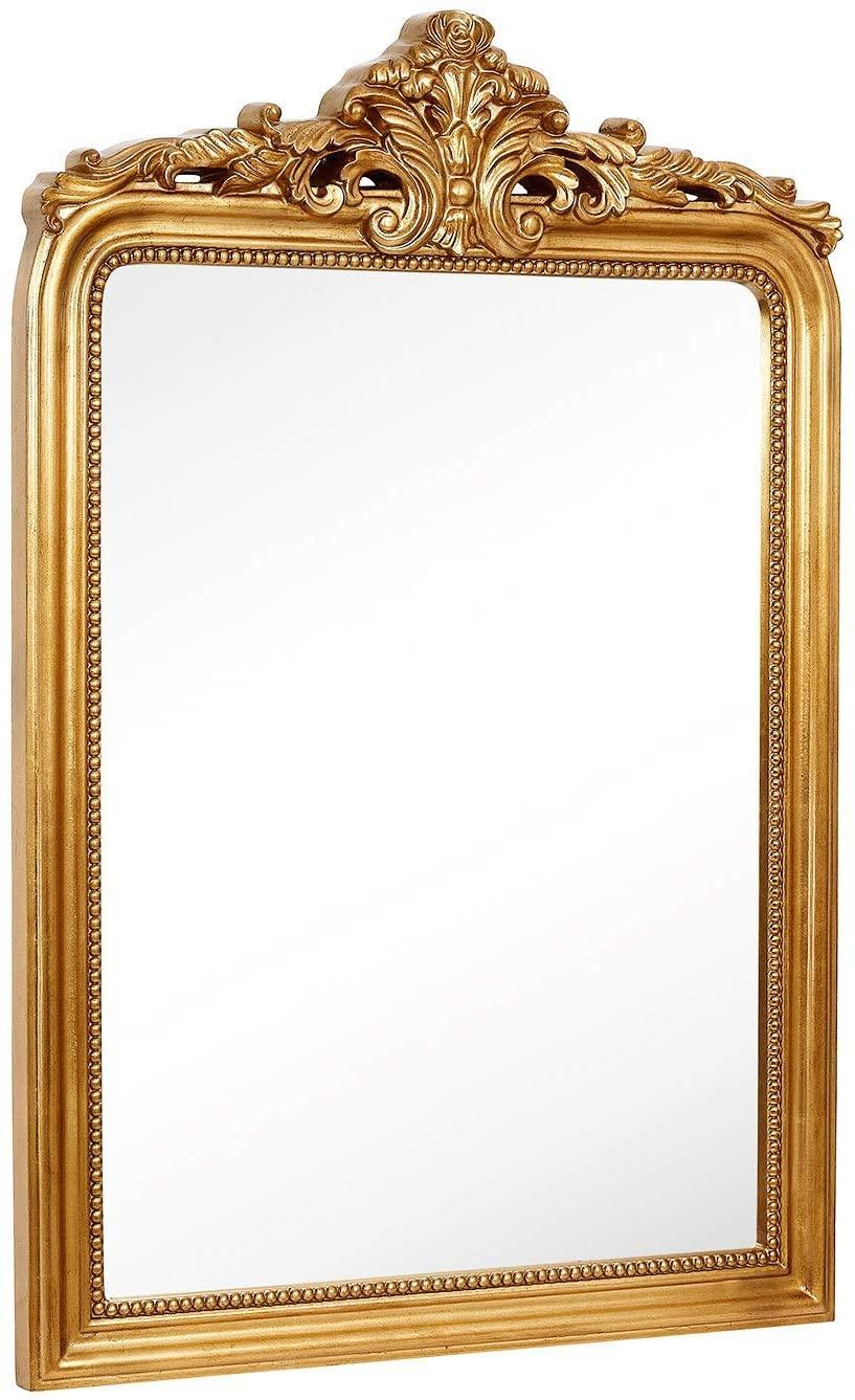 """<h2>Hamilton Hills Gold Baroque Wall Mirror</h2><br>""""I normally buy a lot of my decor and furniture from Home Goods/thrift stores/online resale sites, but I've been hunting for a massive (and quality construction) gold mirror that wasn't going to break the bank for a long time. Mirrors always make spaces feel bigger and brighter. It really made my apartment look nicer, and that feels worth it to me especially since I'm spending most of my time here now. It arrived extremely well-packaged and while the mirror is not made out of solid wood, the construction is high-quality. I also liked that I got the look of an $800 mirror without spending that much money."""" – <a href=""""https://www.instagram.com/beccaohaeri/?hl=en"""" rel=""""nofollow noopener"""" target=""""_blank"""" data-ylk=""""slk:Rebecca O'Haeri"""" class=""""link rapid-noclick-resp""""><em>Rebecca O'Haeri</em></a><em>, Data Analyst</em><br><br><em>Shop <strong><a href=""""https://amzn.to/39RZtfk"""" rel=""""nofollow noopener"""" target=""""_blank"""" data-ylk=""""slk:Hamilton Hills"""" class=""""link rapid-noclick-resp"""">Hamilton Hills</a></strong></em><br><br><strong>Hamilton Hills</strong> Hamilton Hills Gold Baroque Wall Mirror, $, available at <a href=""""https://www.amazon.com/gp/product/B07CHWM258"""" rel=""""nofollow noopener"""" target=""""_blank"""" data-ylk=""""slk:Amazon"""" class=""""link rapid-noclick-resp"""">Amazon</a>"""