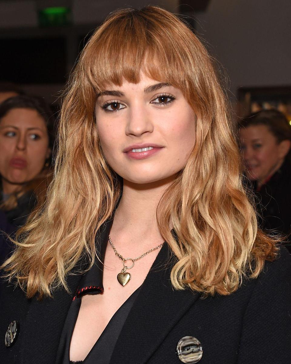 <p>Returning to her Lady Rose/Cinderella-esque roots, Lily James added a 70s vibe curved fringe to her new honey blonde hair and we're feeling it. V groovy Lily.</p>
