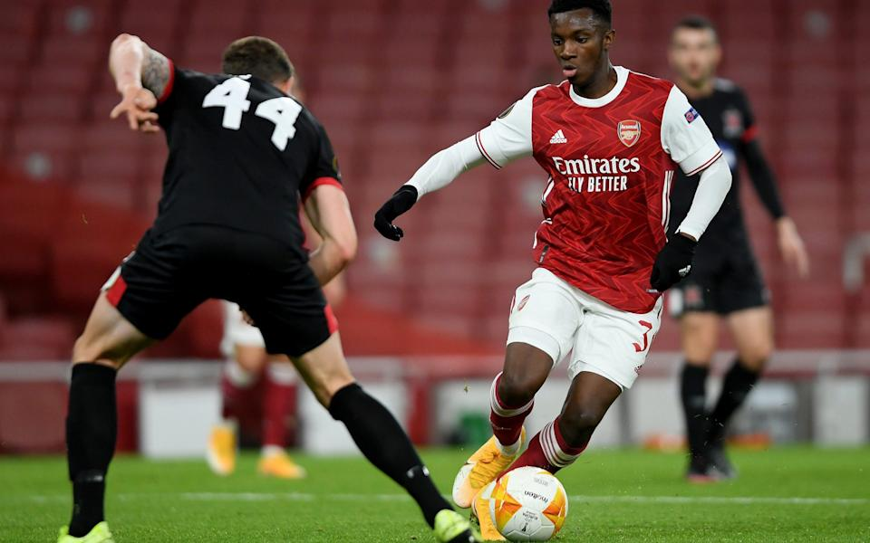 Eddie Nketiah of Arsenal takes on Andy Boyle of Dundalk during the UEFA Europa League Group B stage match between Arsenal FC and Dundalk FC at Emirates Stadium on October 29, 2020 in London, England. Sporting stadiums around the UK remain under strict restrictions due to the Coronavirus Pandemic as Government social distancing laws prohibit fans inside venues resulting in games being played behind closed doors - Getty Images Europe /Mike Hewitt