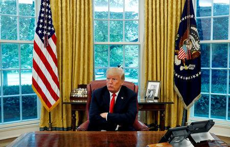 U.S. President Trump reacts to a question during interview with Reuters in the Oval Office of the White House in Washington
