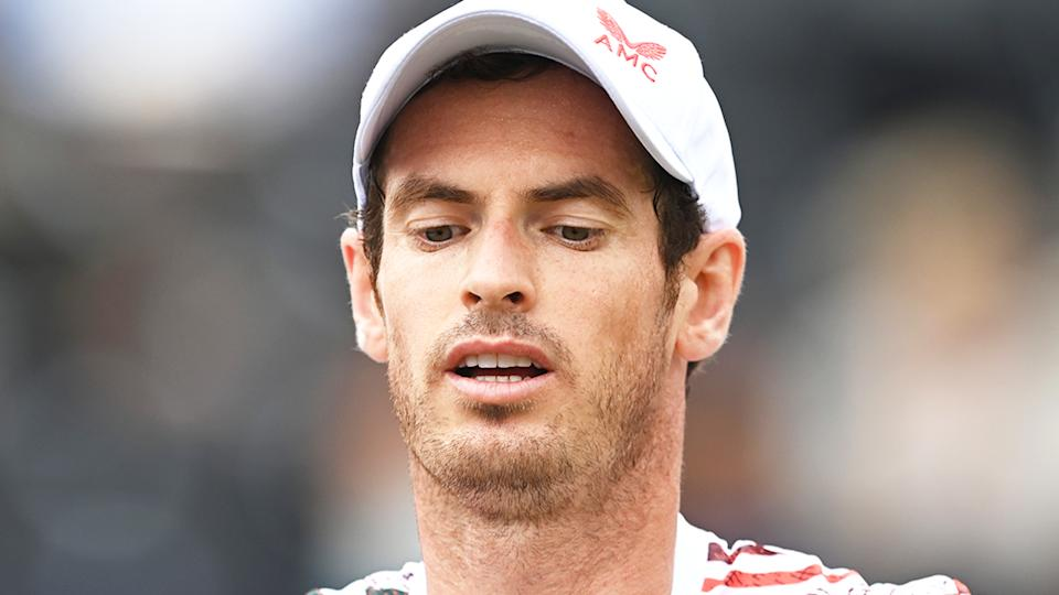Andy Murray (pictured) fixing his racquet between points at Queen's.