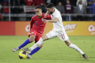 U.S. defender Sergino Dest, left, moves to get position on Canada midfielder Jonathan Osorio (21) during the second half of a CONCACAF Nations League soccer match Friday, Nov. 15, 2019, in Orlando, Fla. (AP Photo/John Raoux)
