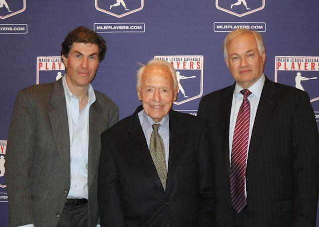 FILE - In this April 24, 2012, file photo provided by the Major League Baseball Players Association, Michael Weiner, left, MLBPA executive director; Marvin Miller, center, former head of the association; and Donald Fehr, former MLBPA executive director and currently the executive director of the NHL Players' Association, gather for a photo at New York University School of Law in New York. Weiner, who took over as head of the powerful baseball players' union four years ago, died Thursday, Nov. 21, 2013, 15 months after announcing he had been diagnosed with an inoperable brain tumor. He was 51. (AP Photo/MLBPA, Ashton Ramsburg, File)