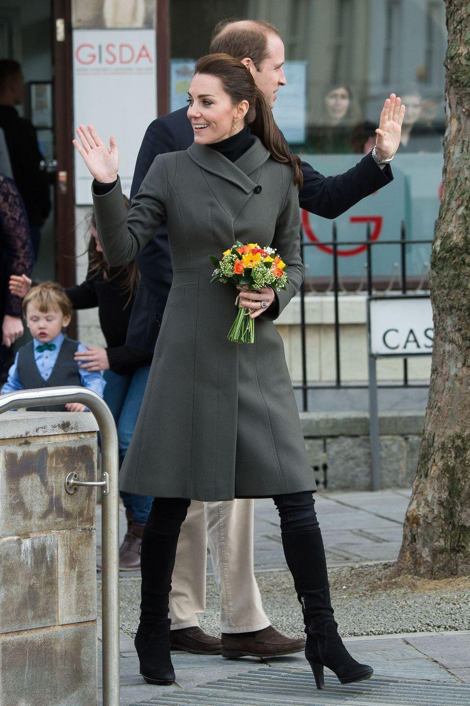 <p>For a trip to North Wales with Prince William, the royal opts for a gray Reiss coat, jeans and knee-high suede boots. </p>