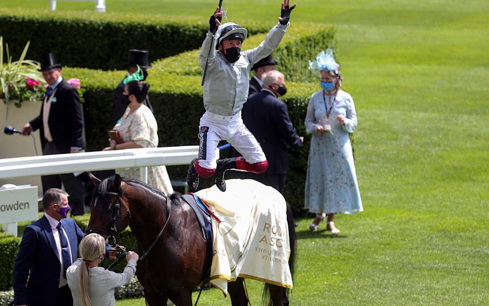 Jockey Frankie Dettori performs his trademark flying dismount as he celebrates winning the Queen Anne Stakes on Palace Pier - PA Wire