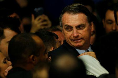 Brazilian President Jair Bolsonaro attends a ceremony of consecration of Saint Mary of the Immaculate Conception at the Planalto Palace in Brasilia