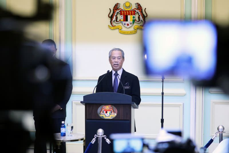 Malaysia's Prime Minister Muhyiddin Yassin speaks during his cabinet announcement in Putrajaya