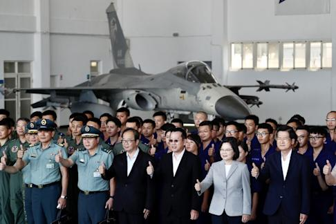 Taiwanese President Tsai Ing-wen poses with air force officials and personnel during her visit at a military base on Penghu Island last month. Photo: EPA-EFE