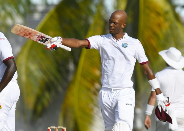 Roston Chase of West Indies celebrates his century on April 30, 2017