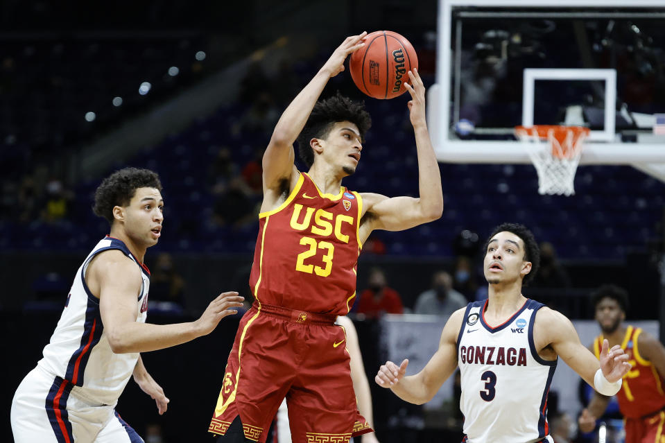 INDIANAPOLIS, INDIANA - MARCH 30: Max Agbonkpolo #23 of the USC Trojans handles the ball during the second half against the Gonzaga Bulldogs in the Elite Eight round game of the 2021 NCAA Men's Basketball Tournament at Lucas Oil Stadium on March 30, 2021 in Indianapolis, Indiana. (Photo by Tim Nwachukwu/Getty Images)