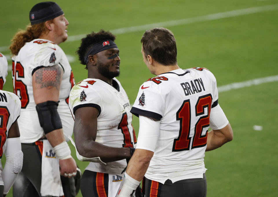 Thanks in part to Tom Brady's discount and the franchise tag on Chris Godwin (middle), the defending champion Tampa Bay Buccaneers have won free agency before it even started. (REUTERS/Shannon Stapleton)