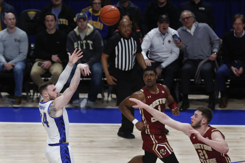 Pittsburgh's Ryan Murphy (24) hits a shot to put Pitt ahead to stay over Boston College's Nik Popovic with under five seconds left in the second half of an NCAA college basketball game, Wednesday, Jan. 22, 2020, in Pittsburgh. Pittsburgh won 74-72. (AP Photo/Keith Srakocic)