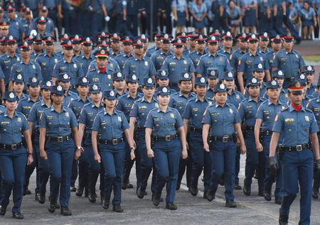 Female policewomen from the Philippine National Police (PNP) march during the National Police chief handover ceremony in Camp Crame, Quezon City, metro Manila, Philippines, April 19, 2018. REUTERS/Dondi Tawatao