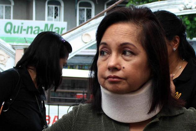 Former president, now Pampanga second-district Representative Gloria Macapagal-Arroyo wearing a neck brace during an activity in Lubao, Pampanga Province, around 100-kilometers north of Manila. Arroyo will have to temporarily wear a neck brace after she was rushed to the hospital yesterday due to a pinched nerve.