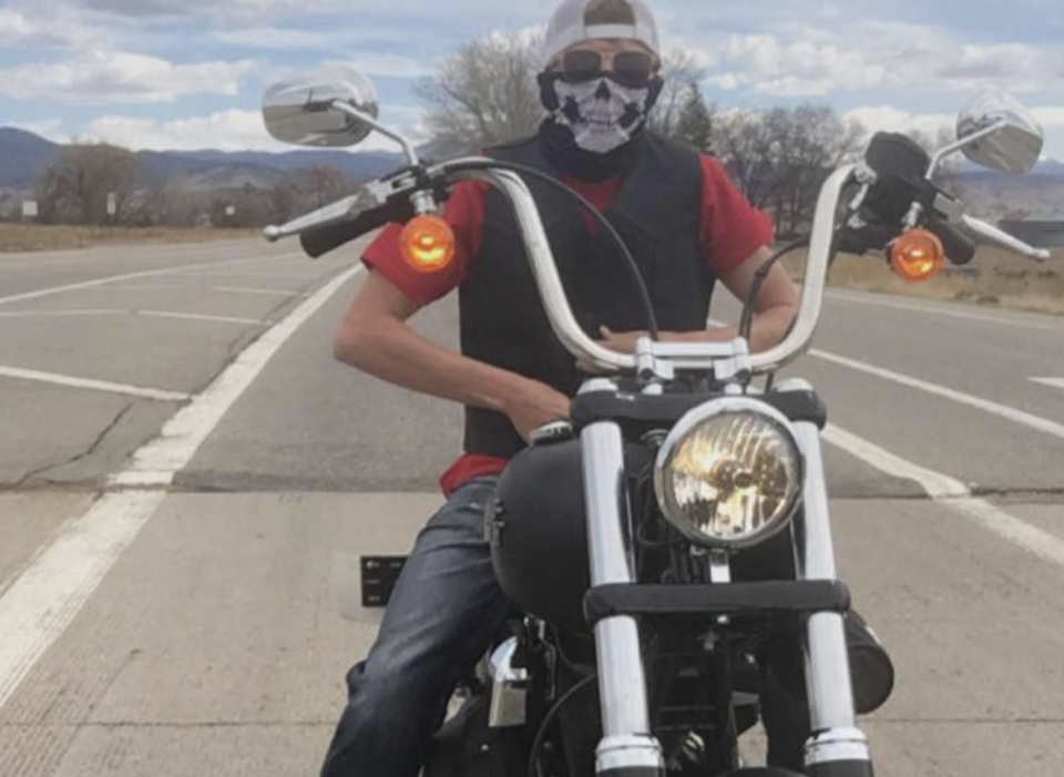 Michael Everett, 23, is pictured on a motorbike.