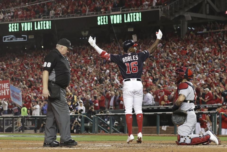 Washington Nationals' Victor Robles reacts as he crosses home after hitting a home run during the sixth inning of Game 3 of the baseball National League Championship Series against the St. Louis Cardinals Monday, Oct. 14, 2019, in Washington. (AP Photo/Jeff Roberson)