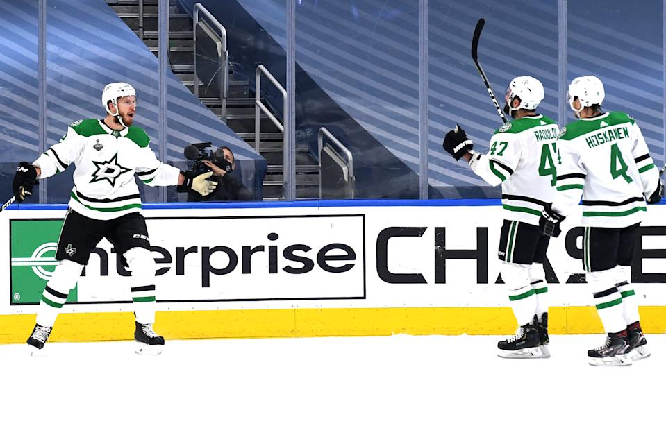 EDMONTON, ALBERTA - SEPTEMBER 19: Jamie Oleksiak #2 of the Dallas Stars celebrates with Alexander Radulov #47 and Miro Heiskanen #4  after Oleksiak scored in the second period of Game One of the NHL Stanley Cup Final between the Dallas Stars and the Tampa Bay Lightning at Rogers Place on September 19, 2020 in Edmonton, Alberta, Canada. (Photo by Andy Devlin/NHLI via Getty Images)