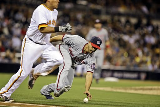 Washington Nationals starting pitcher Gio Gonzalez reaches to pick up a bunt attempt by San Diego Padres' Everth Cabrera in the fifth inning of a baseball game in San Diego, Friday, May 17, 2013. (AP Photo/Lenny Ignelzi)