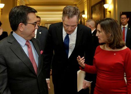 FILE PHOTO: Canadian Foreign Affairs Minister Chrystia Freeland talks to U.S. Trade Rep Robert Lighthizer and Mexican Secretary of Economy Ildefonso Guajardo Villarreal (L) after a NAFTA trilateral ministerial press event in Washington, U.S. on October 17, 2017. REUTERS/Yuri Gripas/File Photo