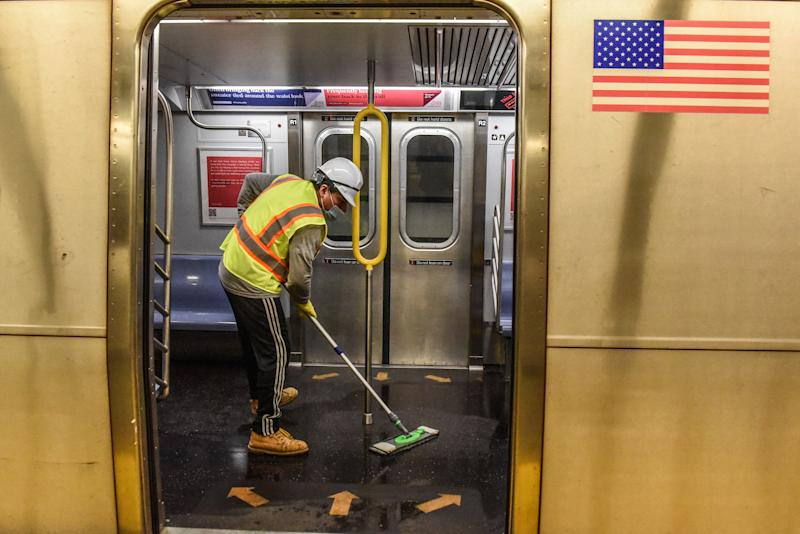 NEW YORK, NY - A cleaning crew disinfects a New York City subway train on May 4, 2020. (Photo by Stephanie Keith/Getty Images)