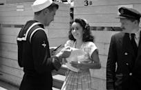 <p>When the actress was only 13 years old she was already hugely famous thanks to her roles in films like <em>Lassie Comes Home </em>and <em>National Velvet</em>. Here she's seen being stopped for an autograph by a sailor. </p>