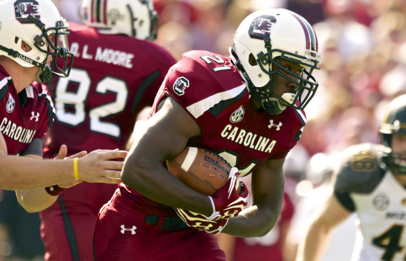 South Carolina running back Marcus Lattimore, looks for a hole in the Missouri defensive line as he rushes for a first down during the first half of an NCAA college football game, at Williams-Brice Stadium in Columbia, S.C., Saturday, Sept. 22, 2012. (AP Photo/Brett Flashnick)