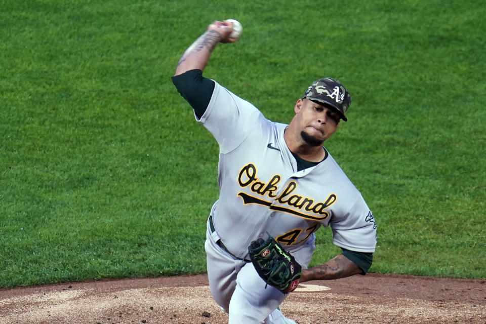 Oakland Athletics pitcher Frankie Montas throws to a Minnesota Twins batter during the first inning of a baseball game Friday, May 14, 2021, in Minneapolis. (AP Photo/Jim Mone)