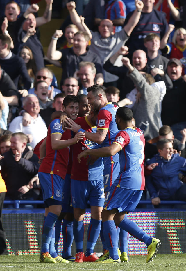 Crystal Palace's players celebrate Chelsea's own goal, during their English Premier League soccer match at Selhurst Park, London, Saturday, March 29, 2014. (AP Photo/Sang Tan)