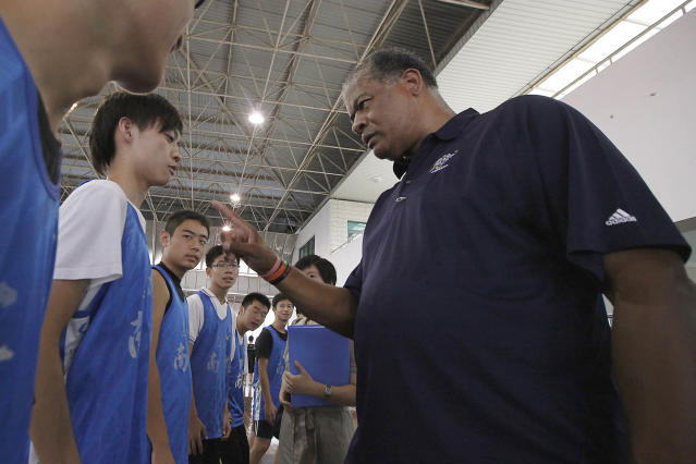 FILE - In this Sept. 7, 2009, file photo, former Washington Bullets legend Wes Unseld teaches a student at a basketball clinic at Nanyang Model High School in Shanghai. Unseld, the Hall of Fame center who led Washington to its only NBA championship and was chosen one of the 50 greatest players in league history, died Tuesday, June 2, 2020, after a series of health issues, most recently pneumonia. He was 74. (AP Photo/Eugene Hoshiko, FIle)
