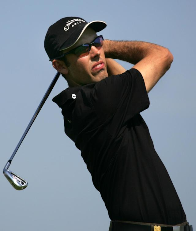 Charl Schwartzel of South Africa watches his ball after teeing off at the tenth, on the second day of the French Golf Open at the Golf National in Saint Quentin en Yvelines, West of Paris, Friday June 24, 2005.(AP Photo/Remy de la Mauviniere)