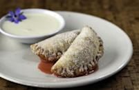 """<p>Forget about carrying a whole pie and extra utensils when you can make these hand pies. These portable desserts are the perfect thing to <a href=""""https://www.thedailymeal.com/25-romantic-little-foods-bring-picnic-date?referrer=yahoo&category=beauty_food&include_utm=1&utm_medium=referral&utm_source=yahoo&utm_campaign=feed"""" rel=""""nofollow noopener"""" target=""""_blank"""" data-ylk=""""slk:pack for a romantic picnic with your partner"""" class=""""link rapid-noclick-resp"""">pack for a romantic picnic with your partner</a>.</p> <p><a href=""""https://www.thedailymeal.com/recipes/strawberry-hand-pies-recipe-0?referrer=yahoo&category=beauty_food&include_utm=1&utm_medium=referral&utm_source=yahoo&utm_campaign=feed"""" rel=""""nofollow noopener"""" target=""""_blank"""" data-ylk=""""slk:For the Strawberry Hand Pies recipe, click here."""" class=""""link rapid-noclick-resp"""">For the Strawberry Hand Pies recipe, click here.</a></p>"""