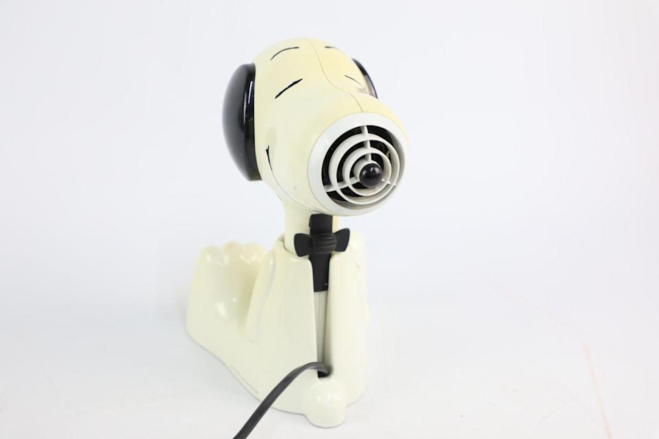 """<p>Did you ever have one of these? Originally a 1950s comic strip character, Snoopy was all the rage, coming in the form of household <a href=""""https://www.housebeautiful.com/uk/garden/g32755466/garden-accessories/"""" rel=""""nofollow noopener"""" target=""""_blank"""" data-ylk=""""slk:accessories"""" class=""""link rapid-noclick-resp"""">accessories</a> and toys. </p><p>According to Vintage Cash Cow, novelty collectible items such as this hairdryer could be worth up to £40. Quick, check the loft!<br></p>"""