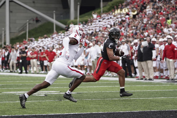 Cincinnati running back Ryan Montgomery, right, runs into the end zone for a touchdown during the first half of an NCAA college football game against Miami (Ohio), Saturday, Sept. 4, 2021, in Cincinnati. (AP Photo/Jeff Dean)