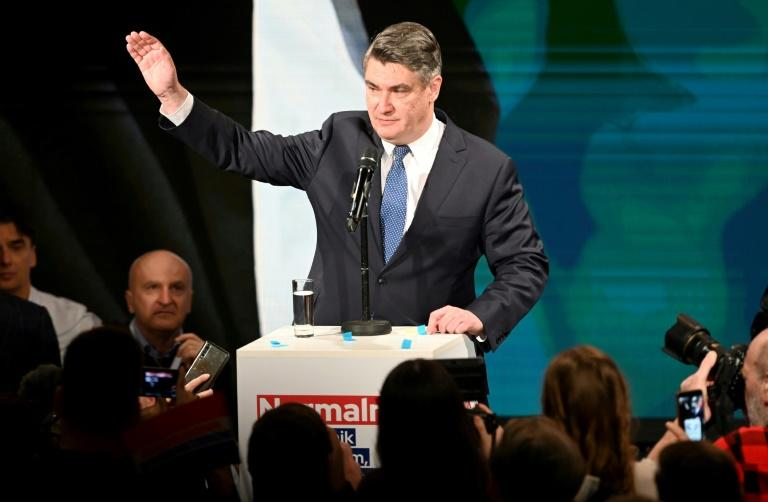 Former PM and presidential candidate of the Social Democratic Party Zoran Milanovic speaks to supporters after taking the lead in the first round vote. (AFP Photo/Denis LOVROVIC)